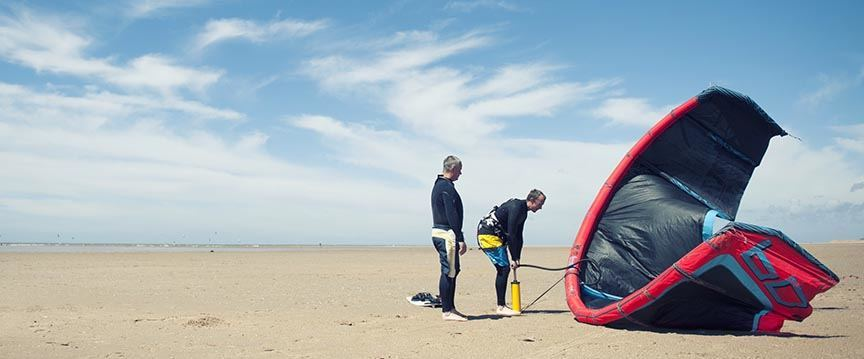 Kite surfers inflating kite