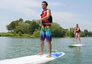 Paddle boarding couple